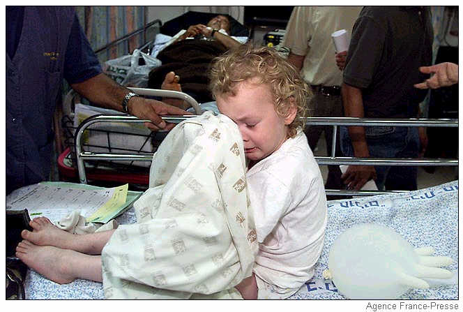 A wounded Israeli baby cries at a Jerusalem hospital.