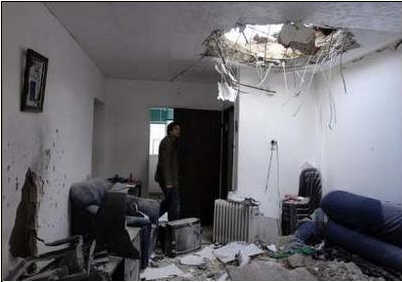Damage to an apartment after a Palestinian rocket struck the coastal city of Ashkelon. (Reuters, February 28)