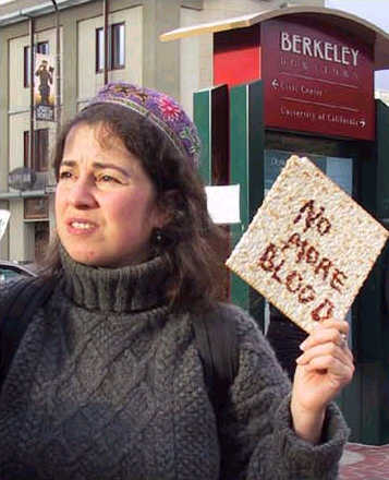 Woman holding matzah with