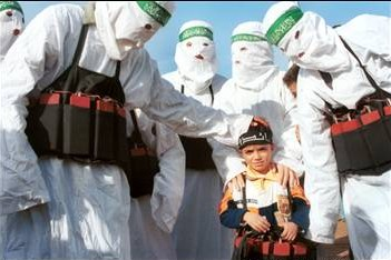 Hamas terrorists teach the art of suicide bombing to a 5-year-old. (Israel News Agency)