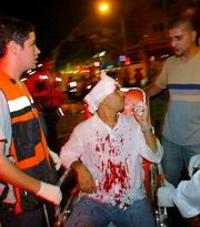 Rescue workers evacuating a man wounded in the suicide bombing in Jerusalem on Tuesday night.