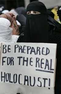 Muslim demonstrator with sign: 'BE PREPARED FOR THE REAL HOLOCAUST!'
