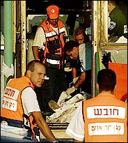 Emergency workers at the scene of the suicide attack in Haifa today.