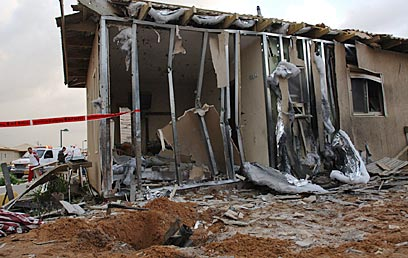 A baby was seriously injured when a Palestinian Qassam rocket struck this house in southern Israel. (Photo: Amir Cohen, for YNET News)