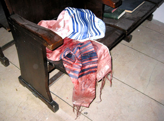 A bloody <i>tallit</i> (prayer shawl) lies on a seat in Istanbul�s Beit Israel synagogue, shortly after the terrorist bombing.